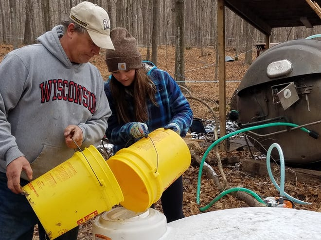 Kevin Schuett and his daughter Haley have been busy collecting sap from the 1000 trees they have tapped in the woods near Lomira.  The entire Schuett family shares an interest in maple syrup making, carrying on the tradition of the Jerome Schwartz, the owner of the woods who has been collecting sap and cooking it in that woods for many decades.