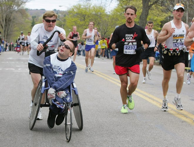 In this 2006 file photo, Dick Hoyt pushes his son Rick through Newton, Mass., during their 25th Boston Marathon together.