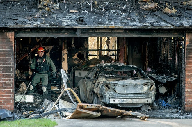 Arson investigator Chad Messersmith works at a fatal house fire on Little Fatima Lane in Northeast Austin on Friday March 19, 2021. Austin-Travis County EMS medics also responded andpronounced one person dead at the scene of the fire.