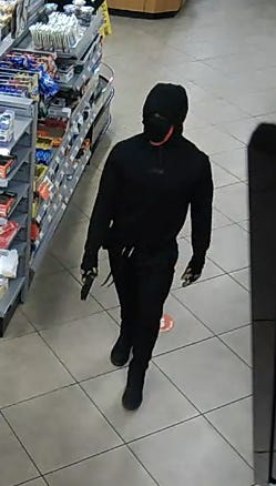 Investigators are trying to identify this person, who killed a clerk early Friday at the RaceTrac station on U.S. Highway 441 on the outskirts of Watkinsville.