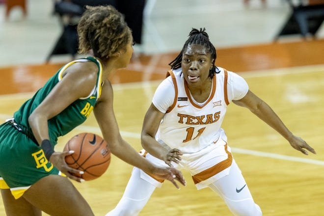 Texas guard Joanne Allen-Taylor defends Baylor's DiDi Richards during their game in Austin on March 1. This season, Texas is allowing 4.4 made 3-pointers per game.