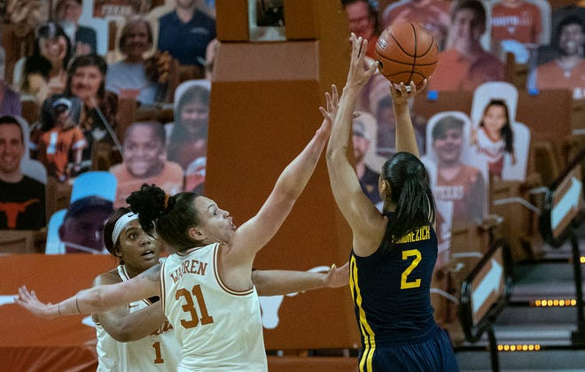Texas' Audrey Warren and Lauren Ebo attempt to defend a shot by West Virginia guard Kysre Gondrezick during their game in Austin on Feb. 6. Texas will play Bradley in its NCAA Tournament opener on Monday night.