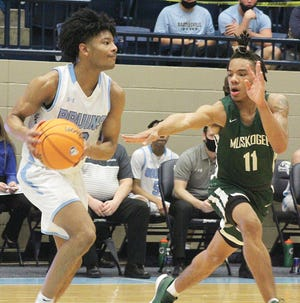 Bartlesville High School freshman David Castillo, left, looks to create a play during varsity boys basketball action this past season against Muskogee High School.