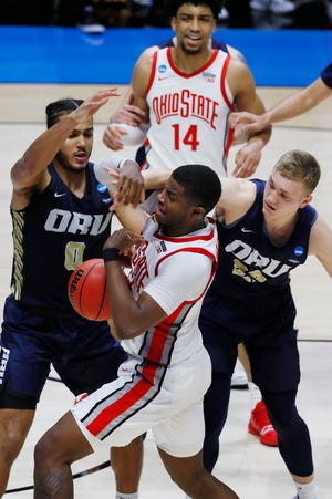 Mar 19, 2021; West Lafayette, Indiana, USA; Ohio State Buckeyes forward E.J. Liddell (middle) battles for the ball agains tOral Roberts Golden Eagles forward Kevin Obanor (0) and forward Francis Lacis (right) during the second half in the first round of the 2021 NCAA Tournament at Mackey Arena. Mandatory Credit: Joshua Bickel-USA TODAY Sports