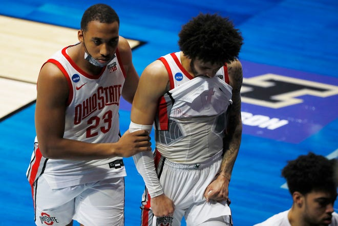 Mar 19, 2021; West Lafayette, Indiana, USA; Ohio State Buckeyes forward Zed Key (23) and guard Duane Washington Jr. (4) react as they leave the court after overtime loss to the Oral Roberts Golden Eagles in the first round of the 2021 NCAA Tournament at Mackey Arena. Mandatory Credit: Joshua Bickel-USA TODAY Sports