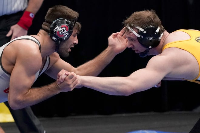 Kaleb Romero, left, of Ohio State scraps with Peyton Mocco of Missouri in a  second-round match at 174 pounds at the NCAA wrrestling championships on Thursday. Romero won 5-1.