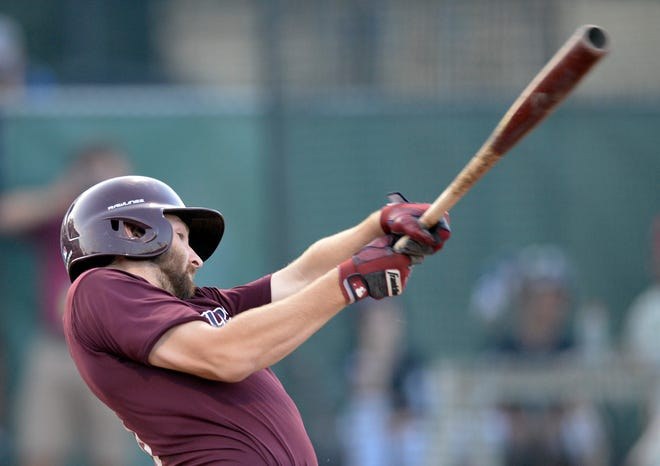 Cotuit catcher Cody Pasic swings away against Harwich in August 2019.