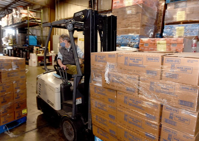 Daryle Bascom, chief operating officer at the Food Bank of Central and Northeast Missouri, unloads a pallet of McRibs sauce from a McDonalds truck on Friday at the Food Bank. Local McDonald's owner/operators donated 97,200 McRib patties and 2,608 sauce pouches to the Food Bank.  McDonald's restaurant owners Ryan Ruprecht, Mark Mehle, Andy Ruprecht, Stephani Marshall-Rice, Rusty Rice, Chuck Marshall, and Chip and Teresa McGeehan own and operate 30 restaurants throughout the Food Bank for Central and Northeast Missouri's 32-county service area.