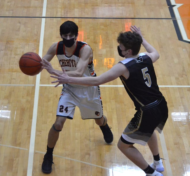 Cheboygan senior center Jacob Grondin (left) makes a pass against St. Ignace on Wednesday. Grondin finished with 12 points for the Chiefs in a loss to Rudyard in their regular season finale on Thursday.