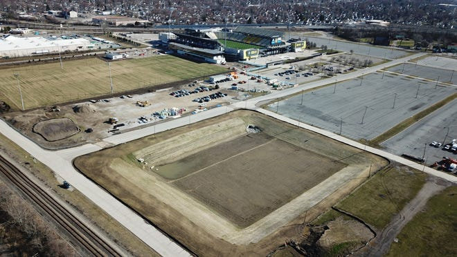 Soccer fields that are part of the Columbus Crew training facility at Historic Crew Stadium are under construction along with a retaining pond (foreground) in this file photo, but the city of Columbus has yet to reach an agreement with the Ohio Expositions Commission to lease land where State Fairgrounds parking areas are located into a new public recreational sports park.