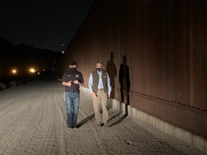 Ohio GOP Sen. Rob Portman accompanies a border patrol agent along the wall with Mexico near El Paso, Texas.