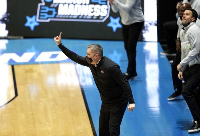 Ohio State Buckeyes Head Coach Chris Holtmann signals his team his team during the first round of the 2021 NCAA Tournament on Friday, March 19, 2021, at Mackey Arena in West Lafayette, Ind.
