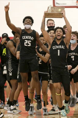 Tasos Cook (1) and Buba Bangura (25) lead the celebration after Westerville Central's regional final win over Gahanna on March 13. Tasos hit the game-winning three-pointer at the buzzer, the second time the Warhawks have kept their run to the state tournament alive with last-second shots.