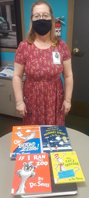 Kim Chiasson displays four of the controversial Dr. Seuss books at the Thibodaux Branch of the Lafourche Parish Library.