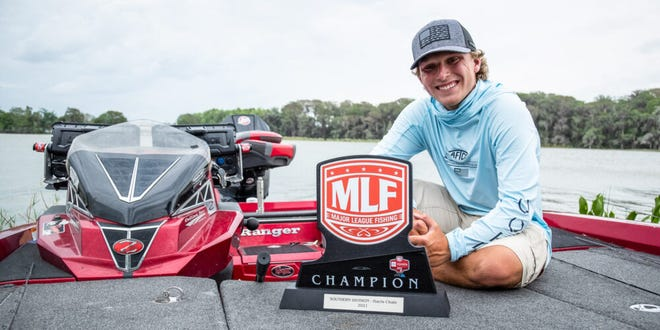 Jordan Thompkins poses with the winner's trophy Thursday after taking top honors at the Major League Fishing Toyota Series Southern Division tour stop on the Harris Chain of Lakes in Leesburg. {COURTESY]