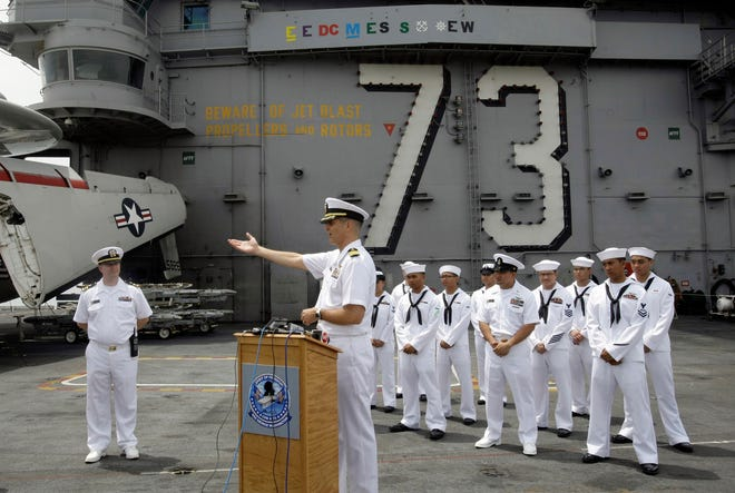 U.S. Navy Capt. David A. Lausman gestures as he briefs media on the flight deck of the USS George Washington Saturday, Sept. 4, 2010 off the coast of Manila, Philippines. Lausman, a resident of The Villages, is awaiting trial in the Fat Leonard Scandal. (AP Photo/Pat Roque)