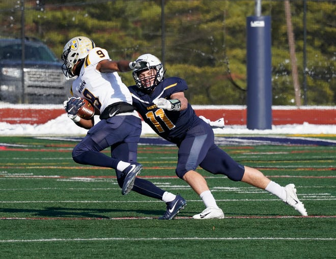 Siena Heights linebacker Kole Murlin goes for a tackle during a game in the 2019 season.