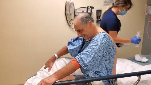 A still image from a video on Volusia County Sheriff Mike Chitwood's social media pages shows the longtime officer in good spirits while a nurse treats injuries he suffered Thursday, March 18, 2021, when he was struck by a car while riding his bicycle.
