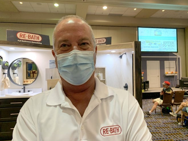 David DenBoer, owner of Re-Bath, stands in front of his display at the News-Journal's 32nd annual Spring Home Show at the Ocean Center in Daytona Beach on Friday, March 19, 2021. The three-day event runs through Sunday. Admission to the public is free.