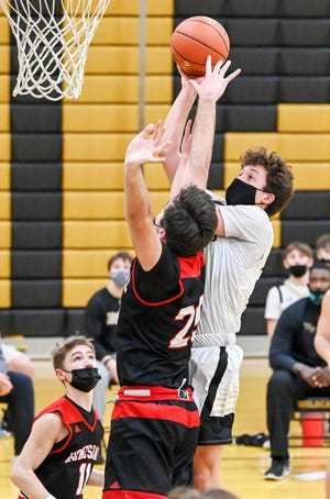 Western Wayne's Ryan Vinton muscles his way to the basket during this year's Lackawanna League Division II boys basketball campaign.