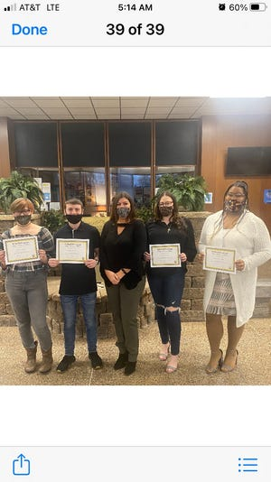 Cosmetology students Natalie Lemay of New Castle High School, Braden McCombs and Szofia Miller of Lincoln High School and Savannah Young of Shenango High School received Lawrence County Career & Technical Center's March 2021 Pride & Promise Award at the school's board meeting on March 18.  The students were awarded the honor for achieving 1,250 hours during their three years of study, and now able to get a temporary license and take the PA State Board examination to be newly licensed hair stylists in Pennsylvania.  (L to R) Natalie Lemay, Braden McCombs, Billy Jo Marino, Szofia Miller and Savannah Young.