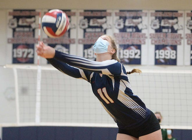 Rockland's Maggie Elie digs during a volleyball game versus Abington, on Thursday, March 18, 2021.