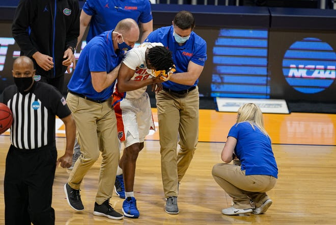Despite losing point guard Tyree Appleby, seen here receiving medical attention after taking a blow to the face, Florida's basketball team showed plenty of resolve in overcoming Virginia Tech 75-70 in overtime Friday in the NCAA tournament.