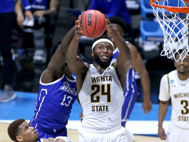 Wichita State'S Morris Udeze (24) rebounds the ball against Drake's Issa Samake (13) during the second half in the NCAA Tournament First Four round at Mackey Arena in West Lafayette, Indiana, on March 18, 2021.