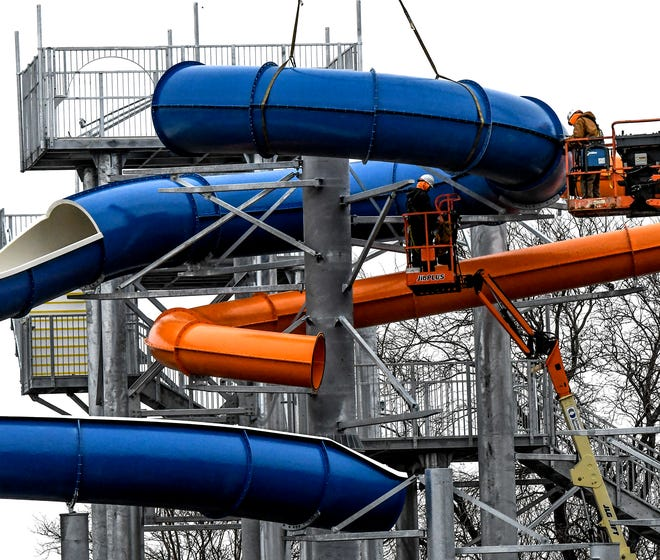Crews fasten a portion of a water slide into place as work continues on the Garden Rapids water park. The park is located on the old Big Pool site in Finnup Park.