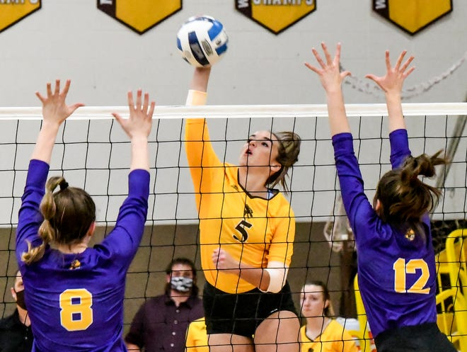 Garden City Community College's Alli Meng, center, drives the ball past Dodge City's Abby Francis, left, and Maria Fernanda Fernaes Alcantara Thursday for a kill at Perryman Athletic Complex. The Broncbusters won the match over their rival in five sets.