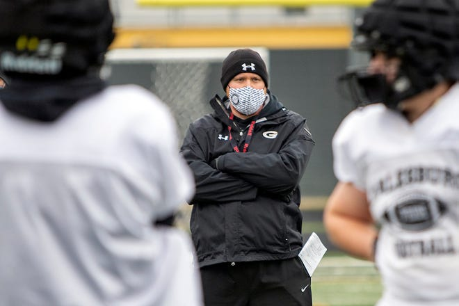 Galesburg High School head football coach Mike Washabaugh keeps an eye on his team during practice on Tuesday, March 16, 2021.