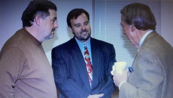 Steve Wyatt, center, is shown in this photo taken Feb. 10, 2006, the day the Board of Commissioners unanimously chose him to become Henderson County manager. Wyatt announced Friday that he is retiring. Then-Board Vice Chair Charlie Messer is pictured at left, with Larry Rogers on the right.