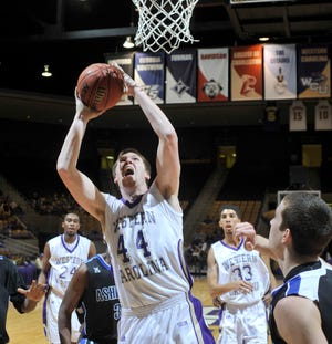 Western Carolina's Sam Smithson goes up for a layup against UNC Asheville during his college playing days. The former West Henderson High standout is now a pastor in South Carolina.