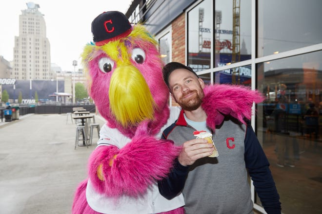 Jeremy Feador, Cleveland Indians team historian/coordinator communications, has a little fun with the Indians' mascot, Slider, during a recent team Purpose Day event.