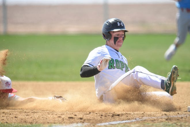 Ropes' Zach Trull (7) slides into first ahead of a tag from Borden County's Justin Willborn (23) during a game at Ropes High School on Friday, March 19, 2021, in Ropesville, Texas. [Justin Rex/For A-J Media]