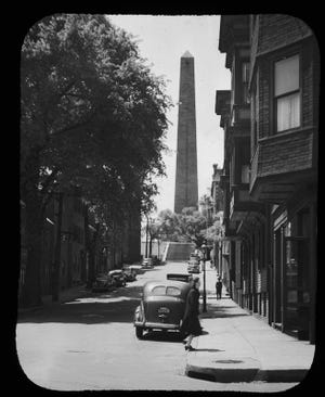 Here is the view of the Bunker Hill Monument as seen from the shadow of an elm on Monument Avenue as it was in the mid-20th century. Learn more from Digital Commonwealth at www.digitalcommonwealth.org.
