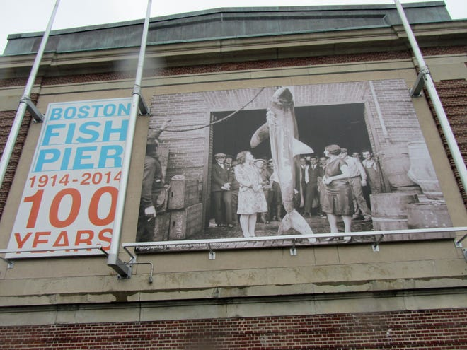 This sign greets visitors to the Boston Fish Pier in Seaport.
