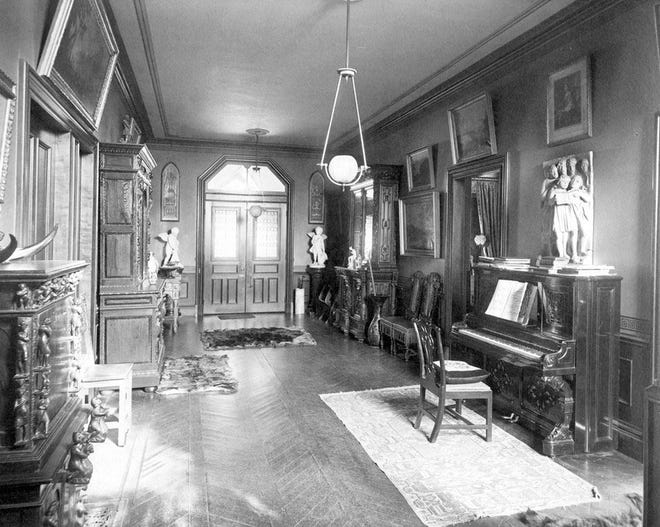 """This is an interior photograph of the entrance hall in the Cleveland House, """"Nutwood,"""" in Jamaica Plain. This photo was probably taken in the late 19th century. Learn more from Digital Commonwealth at www.digitalcommonwealth.org."""