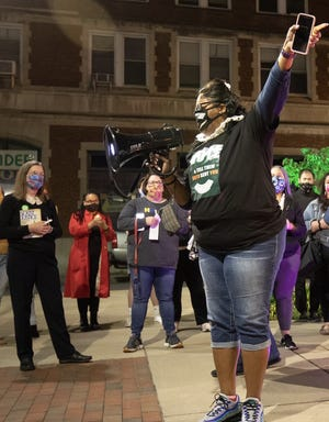 Delegate Danielle Walker, D-Monongalia, speaks in Morgantown at a vigil in honor of Ruth Bader Ginsburg, the Supreme Court justice who died in September.