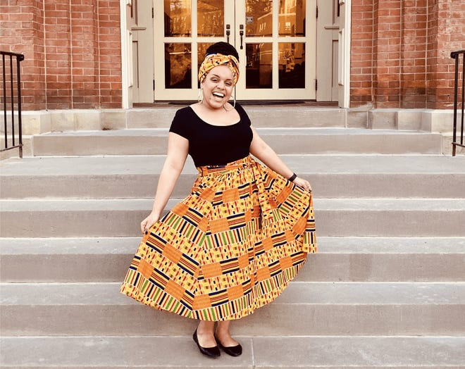 Myya Helm, a 21-year-old student at West Virginia University, poses on campus. Helm said that when lawmakers focus on preserving Confederate monuments over a bill meant to end discrimination based on Black hairstyles, she feels an even stronger push to leave the state.