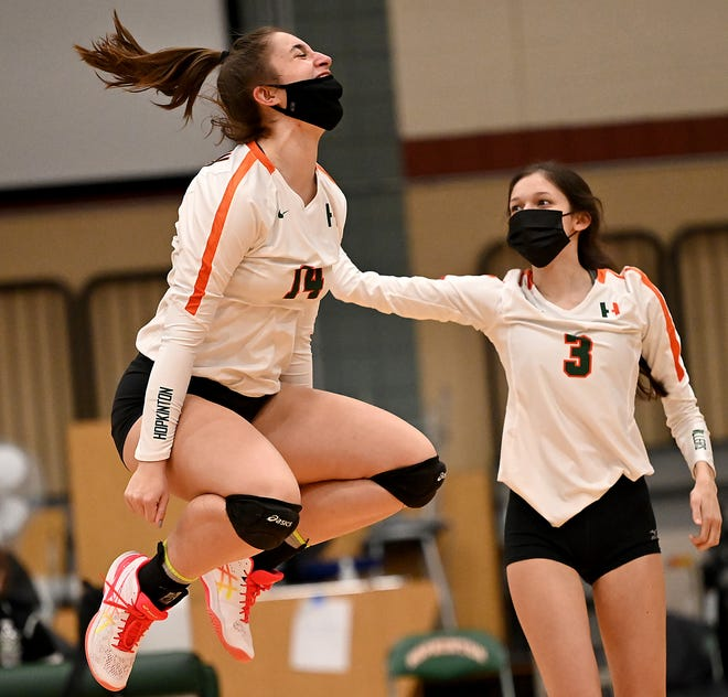 Hopkinton's Kate Powers gets some elevation after her block set up a match-point in the third set of the Hillers 3-0 sweep of Ashland at Hopkinton High School, March 18, 2021.  At right is teammate Mirabella Paolucci.