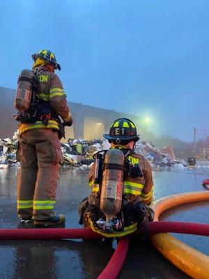 Firefighters battle a blaze at a Washington Street transfer station in Holliston, March 18, 2021.