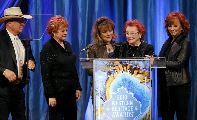 The McEntire family, from left, Pake McEntire, Alice Foran, Susie McEntire Eaton, Jackie McEntire and Reba McEntire accept the 2019 Hall of Great Westerners award for the late Clark McEntire on April 13, 2019, during the National Cowboy & Western Heritage Museum's Western Heritage Awards in Oklahoma City.