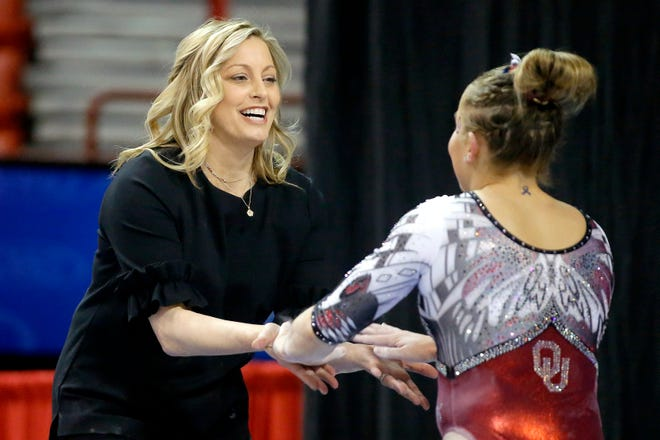 Coach K.J. Kindler, left, and Olivia Trautman, right, will try to deliver the Sooners their ninth straight Big 12 women's gymnastics title on Saturday.
