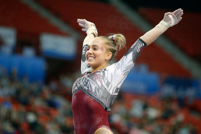 OU's Olivia Trautman smiles after scoring a 10 on the vault during the Perfect 10 Challenge against Stanford on Feb. 21, 2020, in Oklahoma City.