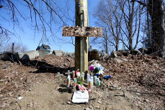 At the site a fatal crash on Sixth Street in Dover a cross is decorated with candles and flowers Friday, March 19, 2021, after two Rochester men were killed in an accident March 18.