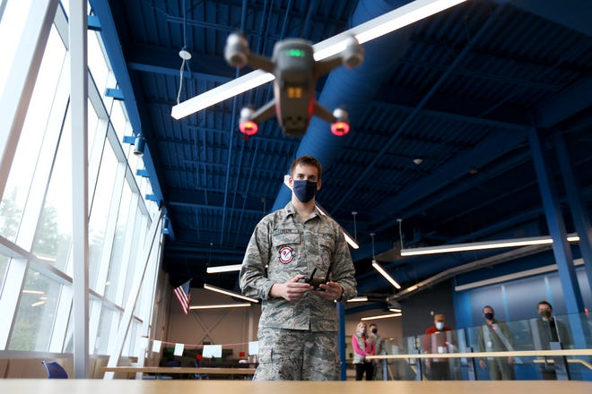 Air Force Junior ROTC cadet Spencer Lemelin, 17, guides a drone safely to land at Spaulding High School in Rochester.