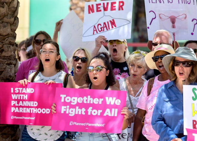 Supporters of Planned Parenthood rally outside City Hall earlier this year in West Palm Beach, Florida.[GREG LOVETT/palmbeachpost.com]