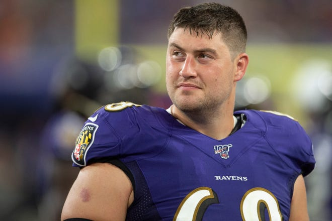 Former Baltimore Ravens center Matt Skura  stands in the bench area. [TOMMY GILLIGAN/USA TODAY Sports]