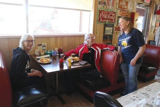 Marcia Stahl, co-owner of Rick's Restaurant, visits with customers Candy Heathman (Pratt) and Johnna Gallaugher (Winfield), welcoming back more and more of the local clientele each day as COVID-19 vaccination shots are distributed and pandemic restictions ease nationwide. The diner is now open from 6 a.m. to 8 p.m. every day except Monday, located along U.S. Highway 54/400 just west of Pratt.